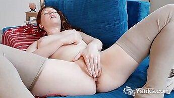 Charming redhead fucking a vibrator on the sensual beach