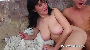 Big tit mom gets cock stretched